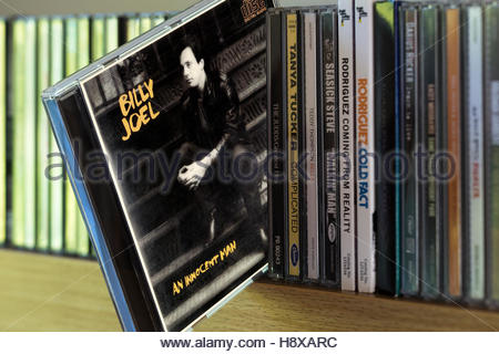 An Innocent Man, Billy Joel CD pulled out from among other CD's on a shelf - Stock Photo