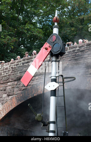 Lower quadrant semaphore starting signal at  on the West somerset Railway, UK - Stock Photo