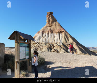 BARDENAS REALES, NAVARRE/SPAIN - AUGUST 16, 2014: Tourists at the Castildetierra landmark at the Bardenas Reales - Stock Photo