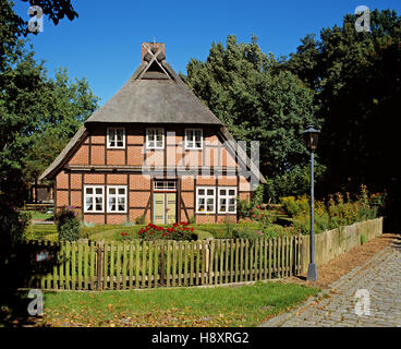 Traditional Lueneburg Heath house at Schroeers Hof, Neuenkirchen, Lower Saxony, Germany - Stock Photo