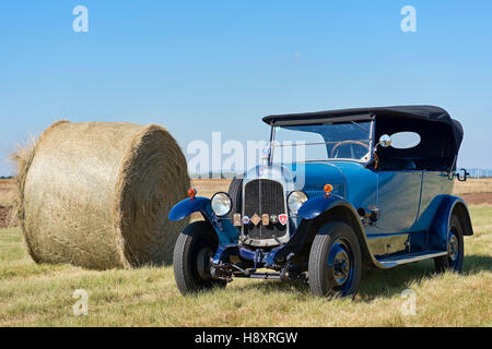 Oldtimer Citroen B10 in hay field, Torpedo Commerciale, made in 1925, 4-cylinder inline engine, engine capacity - Stock Photo