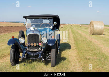 Oldtimer Citroen B10 in hay field, Torpedo Commerciale, made in 1925. 4-cylinder inline engine, engine capacity - Stock Photo