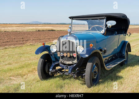 Oldtimer Citroen B10 in hay field, Torpedo Commerciale, built in 1925. 4-cylinder inline engine, engine capacity - Stock Photo