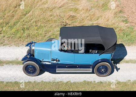 Oldtimer Citroen B10 on gravel road, Torpedo Commerciale, made in 1925. 4-cylinder inline engine, engine capacity - Stock Photo