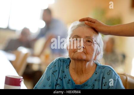 Nursing home, elderly woman with a nurse - Stock Photo