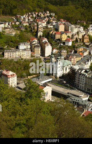 View of Karlovy Vary from Jelení skok, baroque Mary Magdalene Church, West Bohemia, Czech Republic, Europe - Stock Photo
