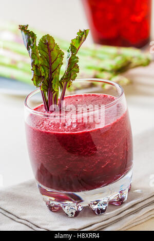 Fresh beet juice with leaves in a glass - Stock Photo