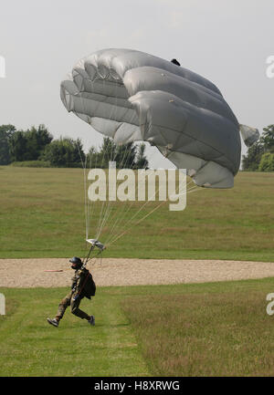 Paratrooper landing with a paraglider beside the target, 13th International Paratrooper Competition of the Special - Stock Photo