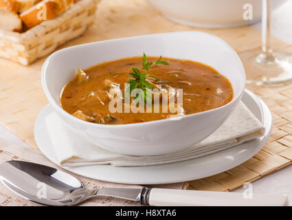 Homemade Cream Of Mushroom Soup With Sliced Mushrooms Served In A Bowl Stock Photo