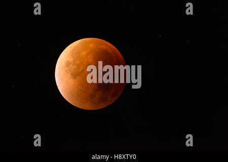 Lunar Eclipse, Red supermoon,  Blood moon / Blutmond, red orange full moon with sparkling stars, 28th September - Stock Photo