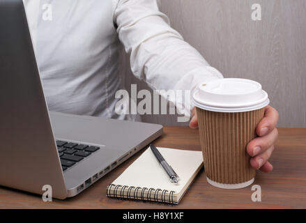 Businessmen drinking coffee from paper cups - Stock Photo