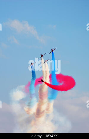 Royal Air Force aerobatic display planes, Red Arrows, fly in cloudy weather - Stock Photo