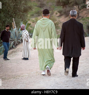 Two male couples walking and talking - Stock Photo