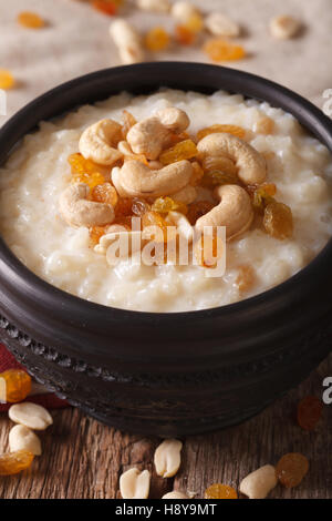 Indian kheer sweet rice pudding with nuts in a bowl macro. vertical - Stock Photo