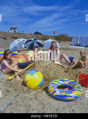 Family playing on shoebury east beach southend. Essex. England. UK - Stock Photo