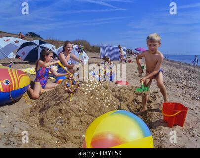 Family playing on shoeburyness east beach southend. Essex. England. UK - Stock Photo