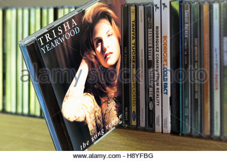 The Song Remembers When, Trisha Yearwood CD pulled out from among other CD's on a shelf - Stock Photo