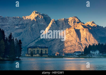 The Marmarole and Sorapiss Groups of the Dolomites tower over Istituto Pio XII - a private hospital on Lago Misurina, - Stock Photo