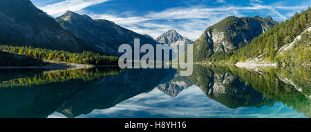 Tyrolean Alps reflected in Plansee, Tyrol, Austria - Stock Photo