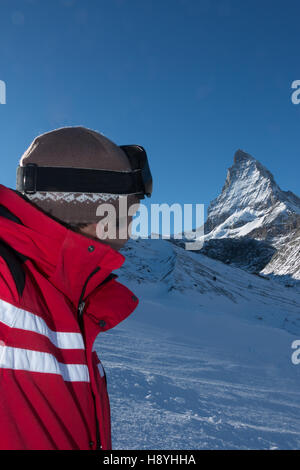 Cervinia Zermatt Ski Instructor looking at the Mont Cervin Cervino Matterhorn from skiing up the the glacier Plateau - Stock Photo