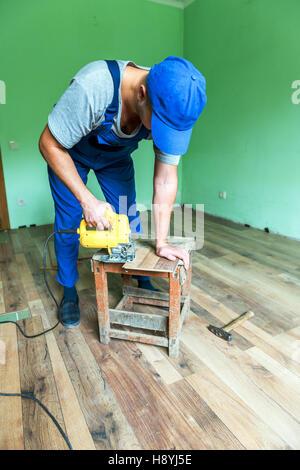 worker install the laminate floor - Stock Photo