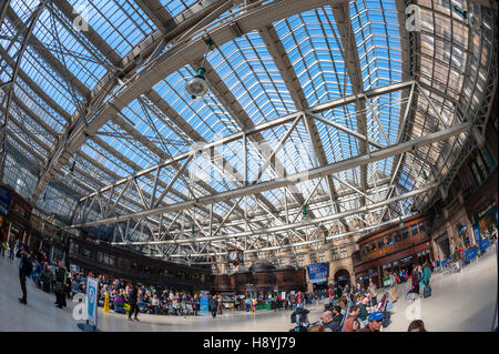 Looking up at the glass roof of Glasgow central station - Stock Photo