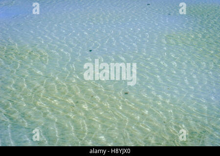 Water surface at Chaqia (Chakayan) salt lake, Qinghai, China - Stock Photo