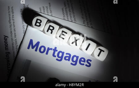 WORD DICE SPELLING 'BREXIT' WITH MORTGAGE INFORMATION LEAFLET RE BREXIT MORTGAGES FIRST TIME BUYERS HOUSE PRICES - Stock Photo