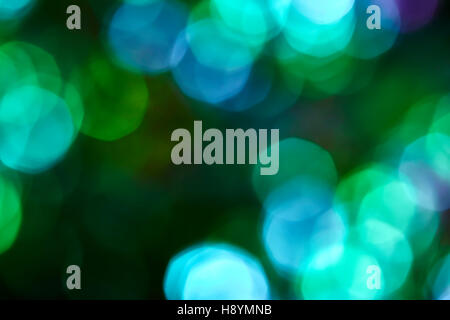Colorful soft circular bokeh overlay for use to enhance images with copy space on a deep twilight blue background