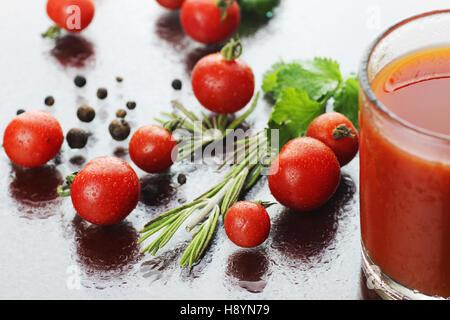 glass of tomato juice drops - Stock Photo