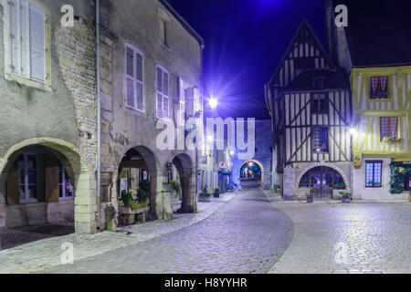 NOYERS-SUR-SEREIN, FRANCE - OCTOBER 11, 2016: Night view of the main square (place de hotel de ville), with half - Stock Photo