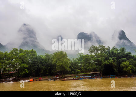 Bamboo rafts on Li river surrounded by karst mountains, Guilin, China - Stock Photo