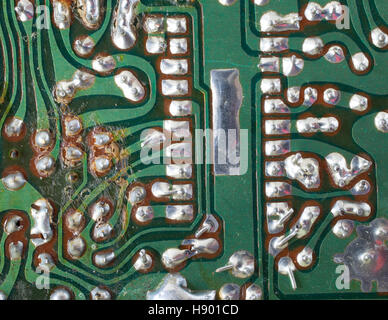 Old circuit board that shows signs of wear and over heating - Stock Photo