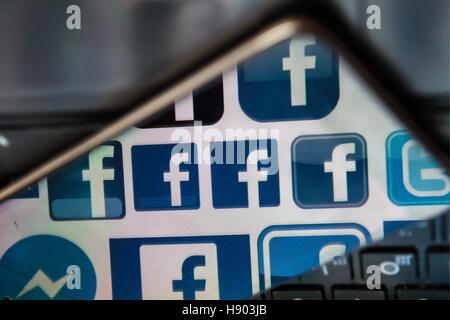 St Petersburg, Russia. 16th Nov, 2016. Facebook logos reflected in a smartphone screen. © Sergei Konkov/TASS/Alamy - Stock Photo