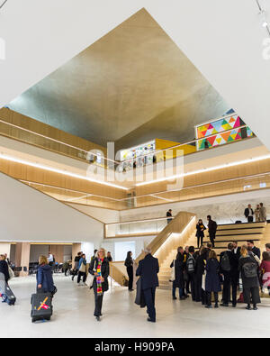 Kensington, London, UK, 17th Nov 2016. Visitors gather in the museum central atrium. Press day for the museum opening. - Stock Photo