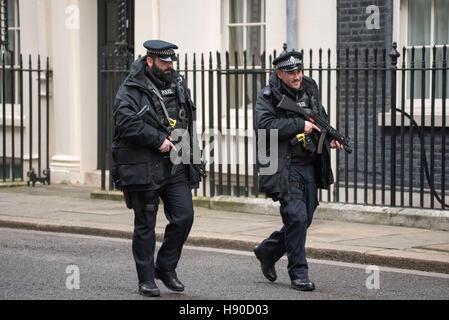 London, UK. 10th January, 2017. Armed police patrol Downing Street Credit: Ian Davidson/Alamy Live News - Stock Photo