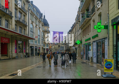 DIJON, FRANCE - OCTOBER 14, 2016: Main street (rue de la liberte) scene of with typical old houses, locals and visitors, - Stock Photo