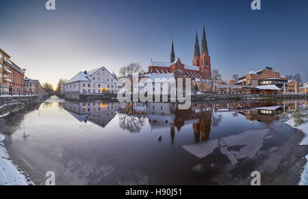 The Cathedral and the Fyris river (Fyrisan) in the winter at Christmas time, Uppsala, Sweden, Scandinavia - Stock Photo