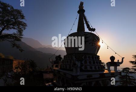 Sunrise at Stupa in Lhagyal Ri,near Tsuglagkhang complex.McLeod Ganj, Dharamsala, Himachal Pradesh, India - Stock Photo