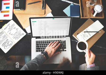 Man Checking Emails Coffee Break Concept - Stock Photo