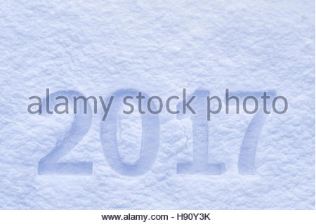 New Year 2017 greeting, 2017 numbers written on snow field, happy new year greeting card, 2017 text, new year background - Stock Photo
