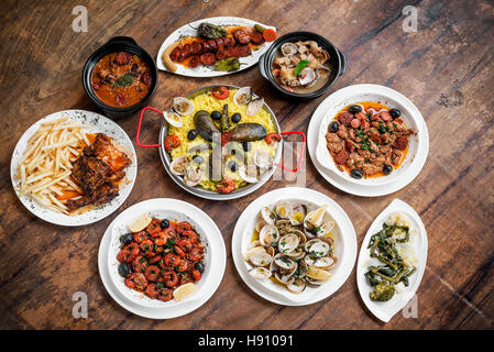 mixed portuguese traditional rustic tapas food gourmet selection on wood table - Stock Photo