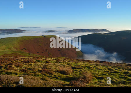 View from the Long Mynd, looking down over clouds in Carding Mill Valley, Church Stretton, Shropshire, UK - Stock Photo