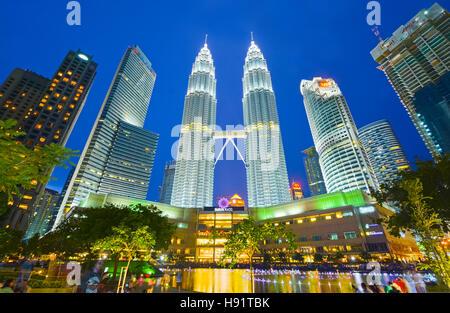 Night view of Petronas twin towers in Kuala Lumpur, Malaysia - Stock Photo