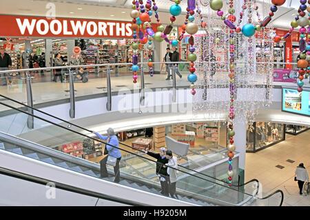 Escalator & Woolworths UK store Essex Thurrock lakeside shopping centre Christmas decorations escalators at Lakeside - Stock Photo