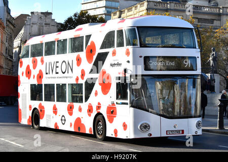 Public transport Boris bus double decker London bus operated by Metroline with poppy graphics to promote Annual - Stock Photo