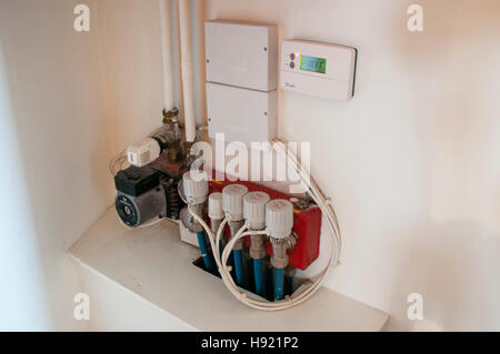 Controls for underfloor heating system. - Stock Photo