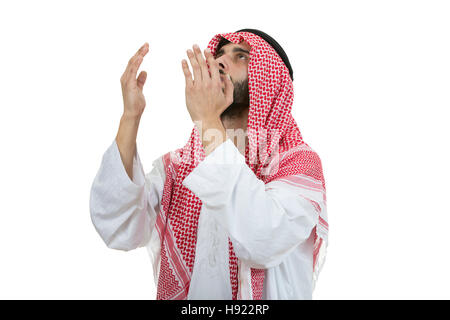 Young arab man of muslim religion praying isolated on white background - Stock Photo