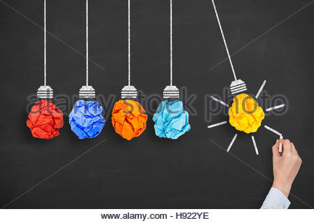 Concept of idea and innovation with light bulb - Stock Photo