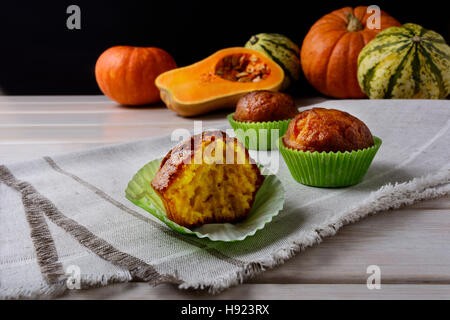 Spiced butternut squash muffins in the green wrappers. Fall seasonal vegetable food. Thanksgiving homemade sweet - Stock Photo